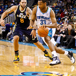 December 17, 2010; New Orleans, LA, USA; New Orleans Hornets shooting guard Willie Green (33) drives past Utah Jazz point guard Deron Williams (8)during the second half at the New Orleans Arena.  The Hornets defeated the Jazz 100-71. Mandatory Credit: Derick E. Hingle