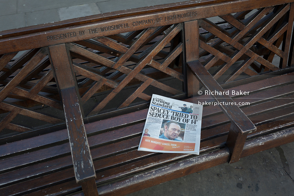 A cop of the Evening Standard with the headline about Kevin Spacey's alleged sexual abuse and announcement of being gay, lies on a bench, on 30th October 2017, in the City of London, England.