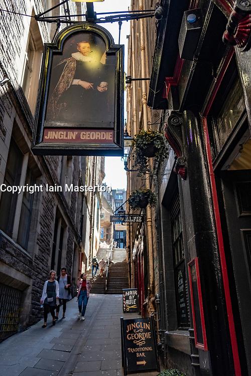 View along Fleshmarket Close at Jinglin' Geordie pub in Old Town of Edinburgh, Scotland, UK