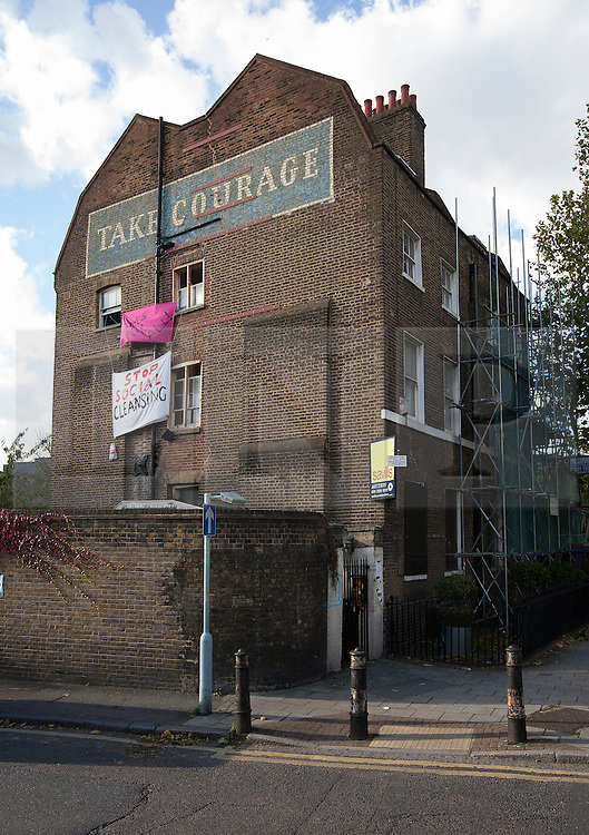 © Licensed to London News Pictures. 29/10/2013. London, UK. An 1820s property occupied by squatters which was sold at auction on Monday for GB£3m is seen on the edge of London's Borough Market today (29/10/2013). The Grade II-listed building, sold by Southwark Council to build 20 new council homes, had been empty for years before squatters from Housing Action Southwark and Lambeth (HASL) moved in. The property, formerly owned by Courage brewers, was acquired by Labour-controlled Southwark Council when the Greater London Council was wound up in 1986. Photo credit: Matt Cetti-Roberts/LNP