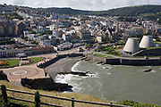 Aerial landscape of Ilfracombe on the English north Devon coast. Ilfracombe is a seaside resort and civil parish on the North Devon coast, England with a small harbour, surrounded by cliffs. The parish stretches along the coast from 'The Coastguard Cottages' in Hele Bay toward the east and 4 miles along The Torrs to Lee Bay toward the west. The resort is hilly and the highest point within the parish boundary is at 'Hore Down Gate', 2 miles inland and 860 feet (270 m) above sea level.