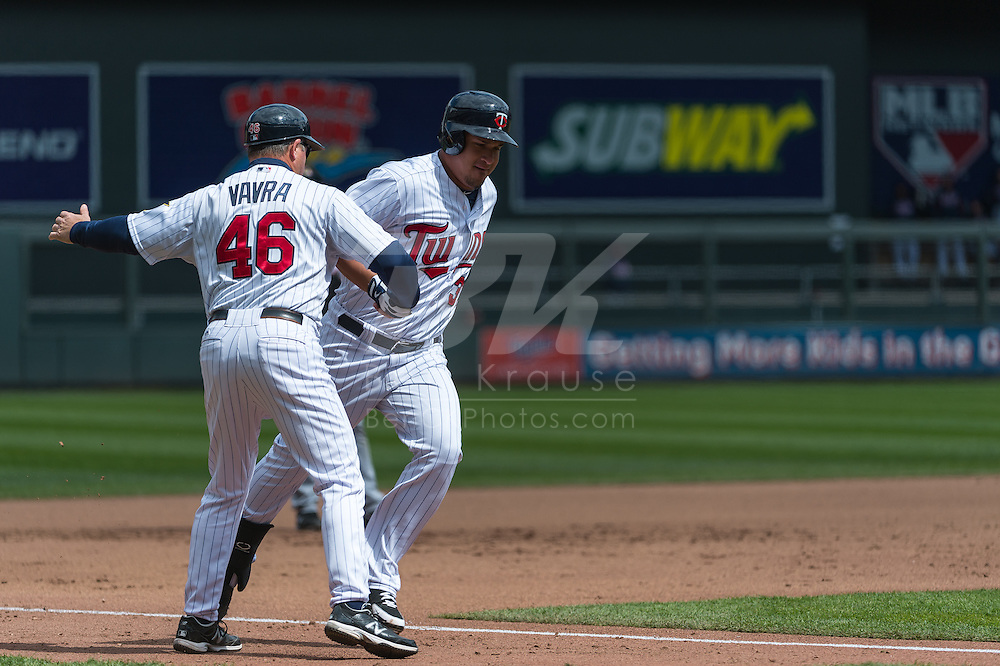 Oswaldo Arcia #31 of the Minnesota Twins is congratulated by 3rd base coach Joe Vavra #46 after hitting a home run in Game 1 of a split doubleheader against the Miami Marlins on April 23, 2013 at Target Field in Minneapolis, Minnesota.  The Twins defeated the Marlins 4 to 3.  Photo: Ben Krause