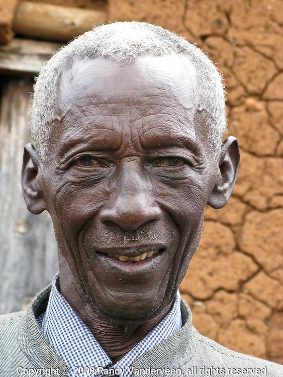 Rwanda - An elderly man pauses for a photo near the door to a neighbour's home in Butare, Rwanda.
