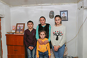 """A portrait of Gregorian family pictured in the reception room of the half-built house on Thursday, Dec 24, 2020 - in Çartar, which is about 47/km far from Stepanakert (Xankendi) in eastern Nagorno Karabakh.<br /> Alosha was reportedly killed in his position by an Azerbaijani shell the family say. """"He was a sniper shooter"""" his father Alihan remembers. Alosha was the father of three children. Two daughters and one son. From the age of 8 from his daughter to 12 years of his son and 15 years of age of his older daughter.<br /> During 44 days of the war, the region saw an end of the conflict after a ceasefire agreement was signed by the leaders of Armenia, Russia and Azerbaijan on 9 November to end the military conflict in Nagorno-Karabakh. Azerbaijani government established the Karabakh Region Authority (KRU) for the districts of Nagorno-Karabakh that came under Baku's control. The city of Stepanakert (Khankendi) is now under the jurisdiction of the KRU of the Ministry of Justice of Azerbaijan. (Photo/ Vudi Xhymshiti)"""