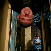 Alexander Mendeleyev, 73, a coal wagon driver, hangs from an exercise bar at his home in Severny. His wife is in the back. .Vorkuta is a coal mining and former Gulag town 1,200 miles north east of Moscow, beyond the Arctic Circle, where temperatures in winter drop to -50C. .Here, whole villages are being slowly deserted and reclaimed by snow, while the financial crisis is squeezing coal mining companies that already struggle to find workers..Moscow says its Far North is a strategic region, targeting huge investment to exploit its oil and gas resources. But there is a paradox: the Far North is actually dying. Every year thousands of people from towns and cities in the Russian Arctic are fleeing south. The system of subsidies that propped up Siberia and the Arctic in the Soviet times has crumbled. Now there?s no advantage to living in the Far North - salaries are no higher than in central Russia and prices for goods are higher.