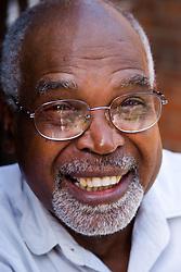 Portrait of older black man smiling,