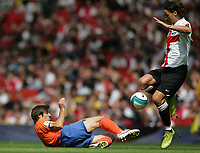 Photo: Lee Earle.<br /> Inter Milan v Valencia. The Emirates Cup. 28/07/2007.Valencia's Carlos Marchena (L) slides in on Zlatan Ibrahimovic.