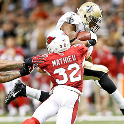 Sep 22, 2013; New Orleans, LA, USA; New Orleans Saints running back Pierre Thomas (23) breaks a tackle by Arizona Cardinals defensive back Tyrann Mathieu (32) during the second half of a game at Mercedes-Benz Superdome. The Saints defeated the Cardinals 31-7. Mandatory Credit: Derick E. Hingle-USA TODAY Sports