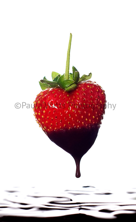 Studio image of strawberry dipped in chocolate