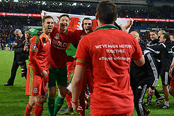 Aaron Ramsey of Wales, Wayne Hennessey of Wales and Gareth Bale pose for photos as they celebrate Qualifying for Euro 2016  - Mandatory byline: Dougie Allward/JMP - 07966 386802 - 13/10/2015 - FOOTBALL - Cardiff City Stadium - Cardiff, Wales - Wales v Andorra - European Qualifier 2016 - Group B