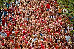 © Licensed to London News Pictures. 04/09/2016. Breda, The Netherlands. Thousands of redheads fill a street in Dutch city Breda to celebrate International Redhead Day event in The Netherlands on Sunday, 4 September 2016. Every year natural redheads from more than 80 countries come together at 'Roodharigendag' annual weekend long festival to celebrate their ginger genes. The event also holds the world record for the largest number of natural redheads being in one place. Photo credit: Tolga Akmen/LNP
