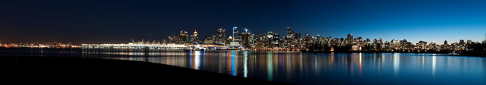 A panoramic cityscape of downtown Vancouver, British Columbia taken at sunset. (Photo Illustration)