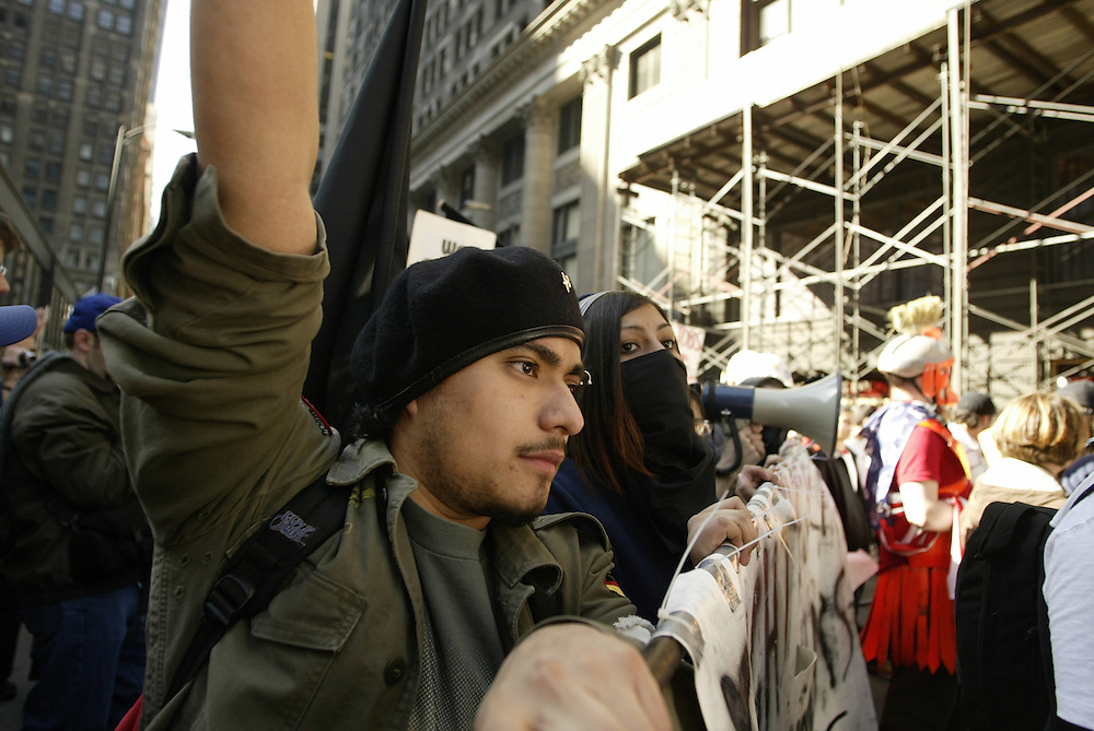 Anti-war protesters take to the streets in downtown Chicago Saturday afternoon contained by thousands of police dressed in riot gear.  The protest was to mark the first anniversary of the war in Iraq.
