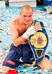 Dejan Zavec alias Jan Zaveck of Slovenia (Red) celebrates after winning against WBF World Champion Sasha Yengoyan (Blue) of Belgium at Fight for World WBF Champion during First Class Boxing event, on April 11, 2015 in Arena Tabor, Maribor, Slovenia. Photo by Vid Ponikvar / Sportida