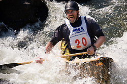 Brian Heikenen of Madison, Wisconsin races in the OC1 men's plastic class during the slalom course of the 42nd Annual Missouri Whitewater Championships. Heikenen placed first place in the class. The Missouri Whitewater Championships, held on the St. Francis River at the Millstream Gardens Conservation Area, is the oldest regional slalom race in the United States.