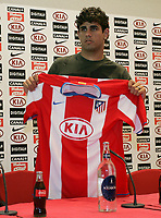 Atletico Madrid's new signing Diego Costa, of Brasil, right, and President Enrrique Cerezo pose with his jersey during his presentation at Vicente Calderon St...