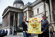 Activists hold up a Van Gogh poster defaced with Shell logos outside the National Gallery. Environmental political activists stage an performance at the national Gallery to protest against Shell's sponsorship of the gallery and the privatisation of the gallery staff.