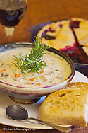 Rosemary chicken with mushroom soup, huckleberry pie and glass of wine at Loulas Restaurant in Whitefish, Montana, USA