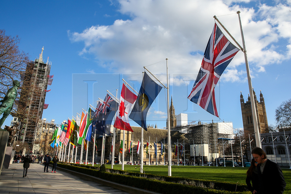 © Licensed to London News Pictures. 06/03/2020. London, UK. Flags of the Commonwealth countries flutter in Parliament Square, to celebrate Commonwealth Day on Monday 9 March 2020. Photo credit: Dinendra Haria/LNP