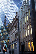 Old and new architecture in the City of London. Old Art Deco building and the modernism of the Gherkin at 1 St Mary Axe.
