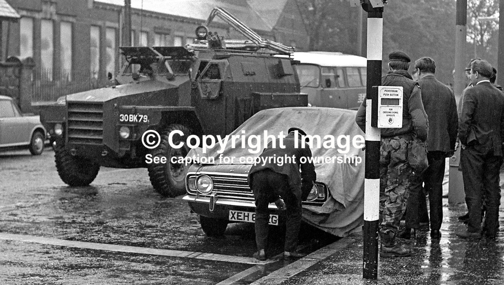 A tarpaulin is tied over the car In which Constables Cecil Cunningham & John Haslett were murdered by the Provisional IRA on 15th October 1971. The two officers were on surveillance duty keeping watch on a savings bank and post office at the junction of Twadell Avenue and the Woodvale Road, Belfast, N Ireland, when the shooting occured.  197110150398b.<br /> <br /> Copyright Image from Victor Patterson, Belfast, UK<br /> <br /> t: +44 28 9066 1296 (from Rep of Ireland 048 9066 1296)<br /> m: +44 7802 353836<br /> e: victorpattersonbelfast@gmail.com<br /> <br /> www.images4media.com<br /> <br /> Please see my full Terms and Conditions of Use at https://www.images4media.com/p/terms-conditions - it is IMPORTANT that you familiarise yourself with them.<br /> <br /> Images used online incur an additional cost. This cost should be agreed in writing in advance. Online images must be visibly watermarked i.e. © Victor Patterson or that of the named photographer within the body of the image. The original metadata must not be deleted from images used online.<br /> <br /> This image is only available for the use of the download recipient i.e. television station, newspaper, magazine, book publisher, etc, and must not be passed on to a third party. It is also downloaded on condition that each and every usage is notified within 7 days to victorpattersonbelfast@gmail.com.<br /> <br /> The right of Victor Patterson (or the named photographer) to be identified as the author is asserted in accordance with The Copyright Designs And Patents Act (1988). All moral rights are asserted.
