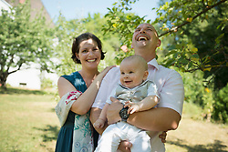 Laughing parents with smiling baby