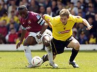 Fotball<br /> England 2004/2005<br /> Foto: SBI/Digitalsport<br /> NORWAY ONLY<br /> <br /> Watford v West Ham United Coca-Cola Championship.<br /> <br /> Dominic Blizzard of Watford challenges West Ham's Nigel Reo-Coker
