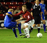 Photo: Dave Linney.<br />Walsall v Macclesfield Town. The FA Cup. 21/11/2006.<br />Walsall's Dean Keates (R) battles with Jamie Tolley.