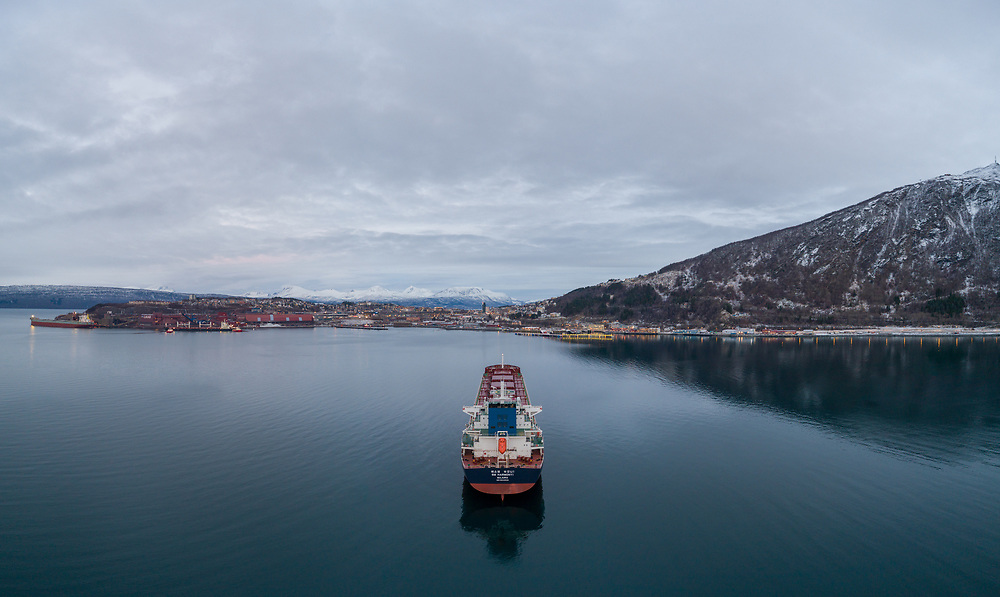 Aerial view of the bulk carrier 'SM Harmony1' at anchor in the port of Narvik in Northern Norway.
