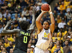 Jan 9, 2018; Morgantown, WV, USA; West Virginia Mountaineers forward Sagaba Konate (50) shoots over Baylor Bears forward Jo Lual-Acuil Jr. (0) during the second half at WVU Coliseum. Mandatory Credit: Ben Queen-USA TODAY Sports