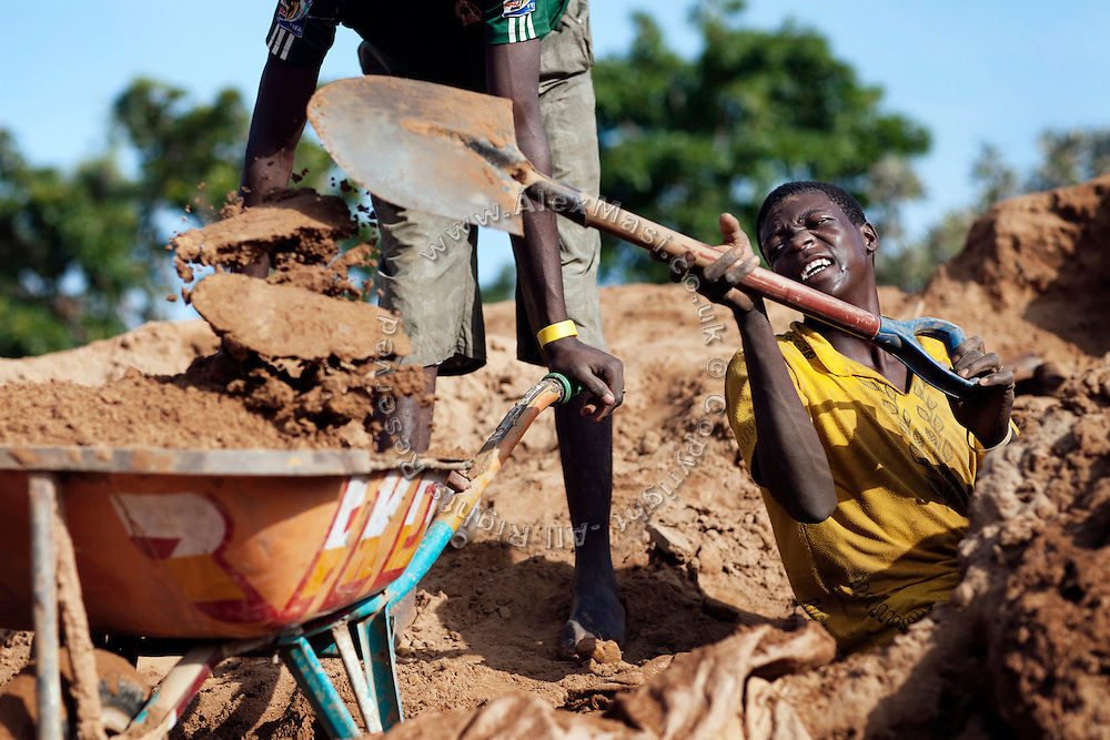 Workers are digging ore dust to be washed to separate gold sediments from other metals, including lead. The gold will then be collected by mixing it with mercury, in an artisanal processing site near Bagega, pop. 9000, a large village affected by lead poisoning due to the unsafe techniques employed for extracting gold, in Zamfara State, Nigeria. The mercury recovered is then burned, revealing unpolished pieces of solid gold. It will be purified in Gusau, where goldsmiths will add sulphuric acid to refine the gold and remove all the impurities. The contamination is caused by ingestion and breathing of lead particles released in the steps to isolate the gold from other metals. This type of lead is soluble in stomach acid and children under-5 are most affected, as they tend to ingest more through their hands by touching the ground, and are developing symptoms often leading to death or serious disabilities.