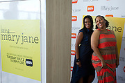 """Guests pose in the photo booth before a screening of BET's """"Being Mary Jane"""" at the W Hotel in Dallas, Texas on June 22, 2013."""