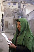 Gandi Gul, widow, mother of 4 holds the death certificate, which she cannot read, of her son Esmail. He was 18 and had fallen in love with a girl but her father didn't approve and arranged with the local Taliban to have Esmail killed.