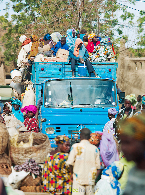 A truck laden with people and goods arrives for the weekly market day in Djenné, Mali