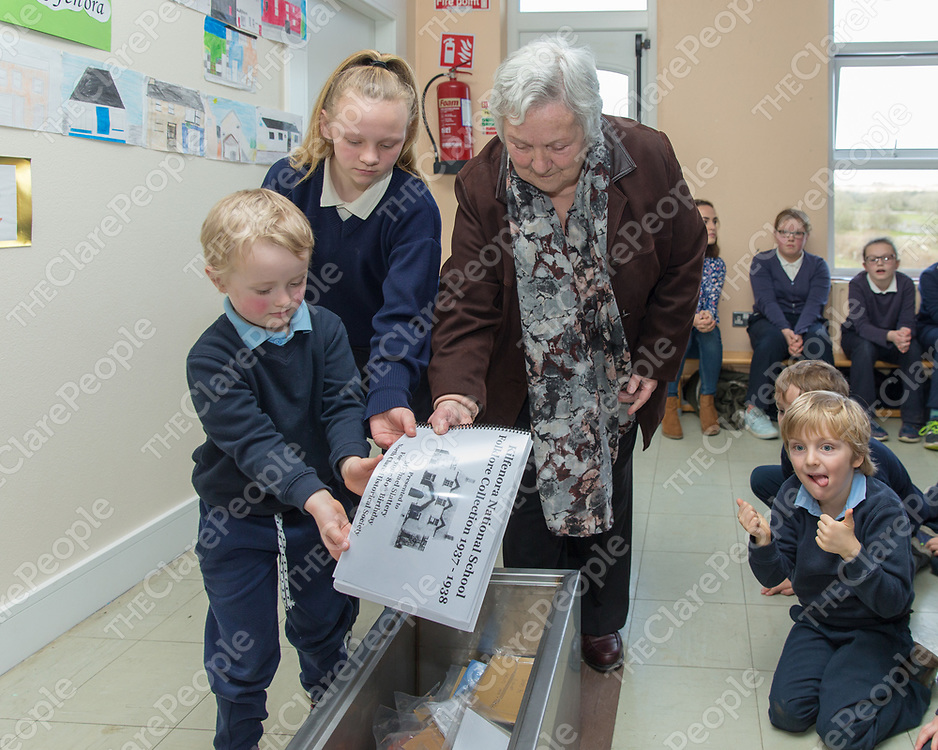 Maura Slattery and students Aoibhin McCormack and Iarla Duffy put a booklet about Kilfenora National School  Folklore into the time capsule