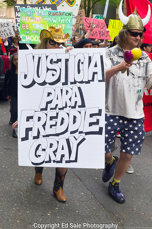 A demonstrator at at 2015 May Day rally and march in Portland, Oregon holds a sign reading Justice for Freddie Gray