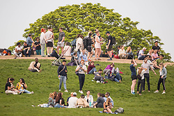© Licensed to London News Pictures. 29/05/2021. London, UK. The public enjoy the sunny weather on Primrose Hill, north London.  Photo credit: Marcin Nowak/LNP