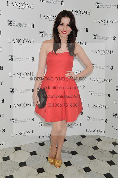 OPHELIA LOVIBOND at the Lancôme pre BAFTA party held at The London Edition, 10 Berners Street, London on 14th February 2014.