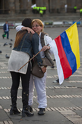 Kolumbien - Friedensvertrag mit der Farc scheitert im Referendum / 021016Bogota, Cundinamarca, Colombia - 02.10.2016        <br /> <br /> <br /> *** The Colombian capital Bogota after the failed peace contract referendum. Supporters of the peace treaty partly crying and embracing each other on the Plaza de Bolivar. In addition, heavy word conflicts with opponents of the peace treaty take place. The Colombian citizens voted tightly against the peace treaty negotiated between the government and the left FARC guerrilla. The FARC has been in war with the Colombian government for 52 years<br /> ***