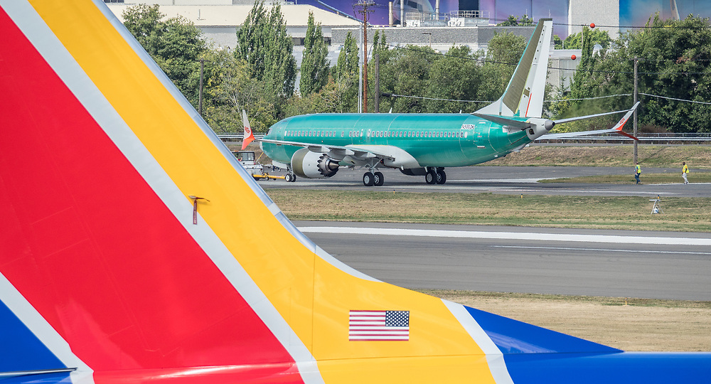 Boeing 737 MAX airplanes outside the Boeing Renton Assembly Plant in Renton, Washington.  Southwest Airlines jet, parked below, another Max being towed, above. 07/27/2019