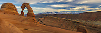 Delicate Arch is the most famous landmark in Arches National Park. The 65 foot tall arch is depicted on Utah license plates and postage stamps. In the background you can see the snowcapped La Sal Mountains.<br />