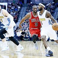 22 November 2016: Denver Nuggets guard Will Barton (5) drives past Chicago Bulls guard Dwyane Wade (3) on a screen set by Denver Nuggets center Jusuf Nurkic (23) during the Denver Nuggets 110-107 victory over the Chicago Bulls, at the Pepsi Center, Denver, Colorado, USA.