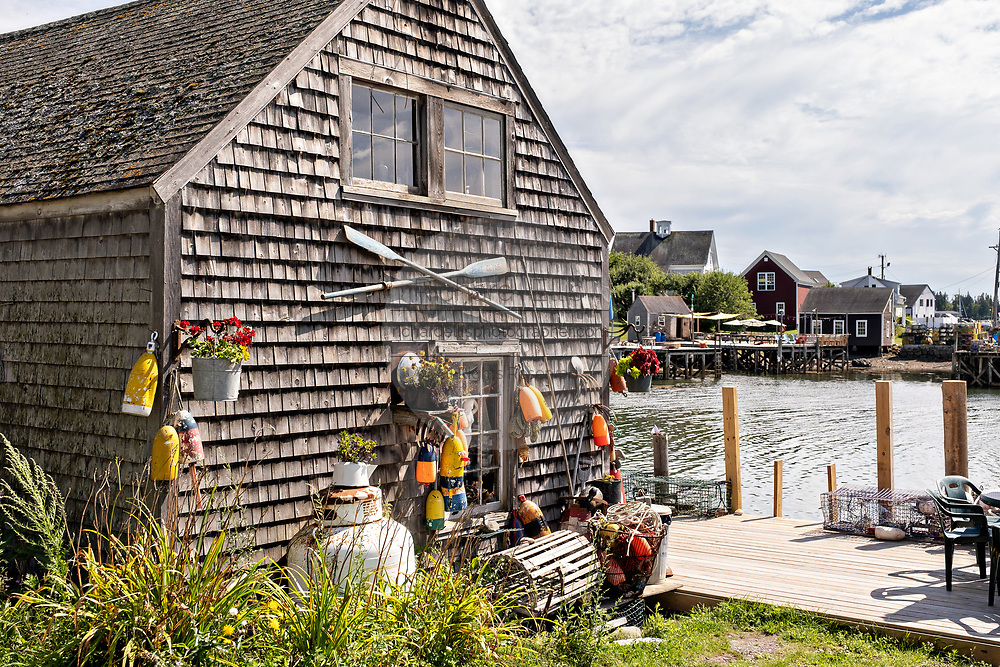 An old boat house decorated in a fishing theme in the quaint fishing harbor of Port Clyde, Maine.