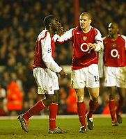 Photo. Chris Ratcliffe, Digitalsport<br /> Arsenal v Bayern Munich. Champions League. 09/03/2005<br /> Kolo Toure cannot believe he has missed this chance as Philippe Senderos watches on