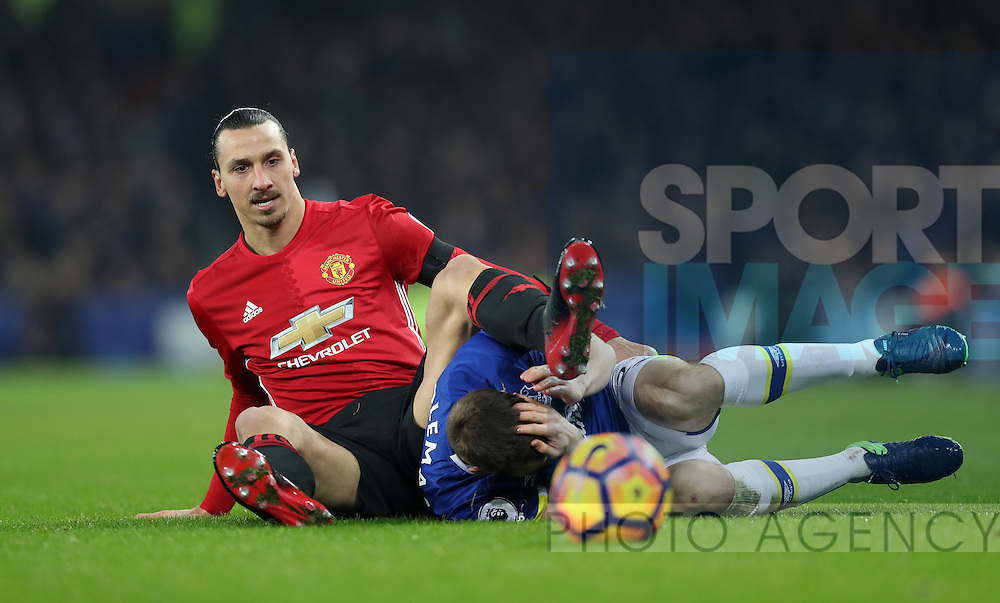 Zlatan Ibrahimovic of Manchester United and Seamus Coleman of Everton during the Premier League match at Goodison Park, Liverpool. Picture date: December 4th, 2016.Photo credit should read: Lynne Cameron/Sportimage