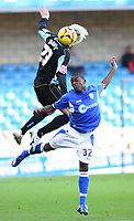 Woods for Rothernham and Williams for Millwall have an air challenge