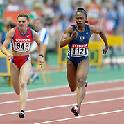 Gail Devers (1121) of the United States and Yuliya Tabakova of Russia (942) in the 100-meter semifinals in the IAAF World Championships in Athletics at Stade de France on Sunday, Aug, 24, 2003.