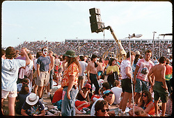 The Crowd before the Grateful Dead Concert at Oxford Speedway on 3 July 1988. The Deadhead Scene ripe with Tie-Dye & Face Paint, Bleachers in Distance, a Relay Speaker Set and Tapers Microphones.