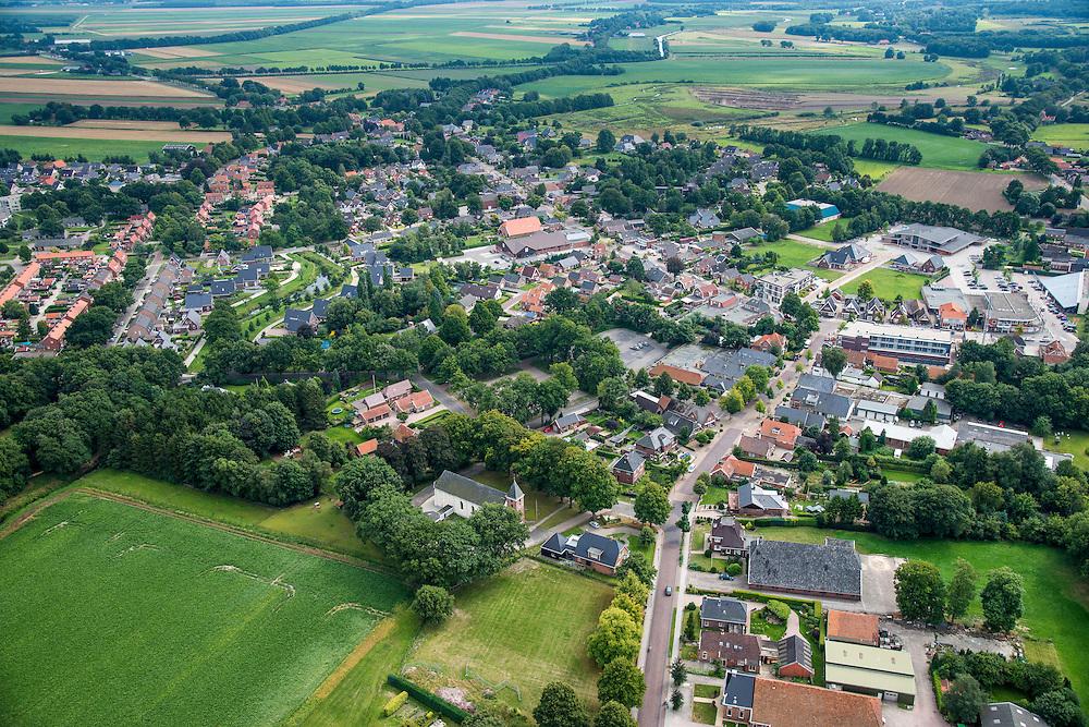 Nederland, Groningen, Gemeente Vlagtwedde, 27-08-2013;<br /> Dorp Vlagtwedde met boerderij, kerk  en voornamelijk laagbouw, vrijstaande woningen en rijtjeshuizen.<br /> The village of Vlagtwedde in the country in north Netherlands.<br /> luchtfoto (toeslag op standaard tarieven);<br /> aerial photo (additional fee required);<br /> copyright foto/photo Siebe Swart.