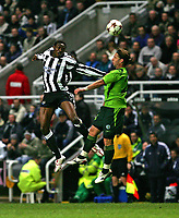 Photo. Andrew Unwin, Digitalsport<br /> Newcastle United v Sporting Lisbon, Uefa Cup Quarter Final First Leg, St James' Park, Newcastle upon Tyne 07/04/2005.<br /> Sporting's Fabio Rochemback (R) wins the ball in an aerial battle with Newcastle's Shola Ameobi (L).